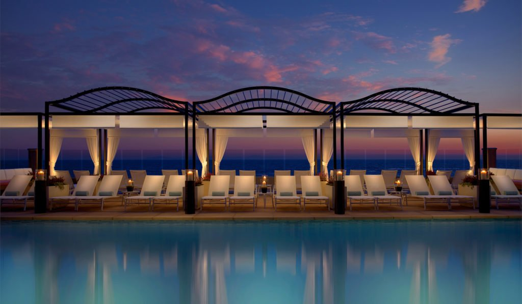 surf and sand resort pool at sunset