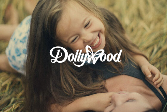 http://Little%20girl%20laughing%20with%20the%20DollyWood%20logo%20superimposed