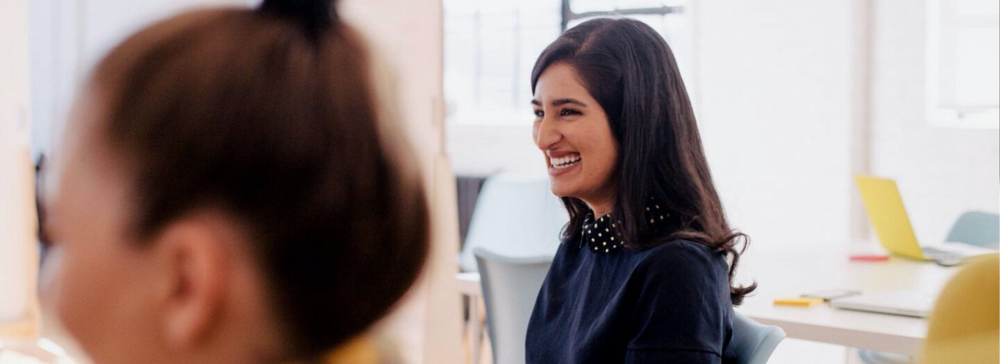 Laughing woman in an office
