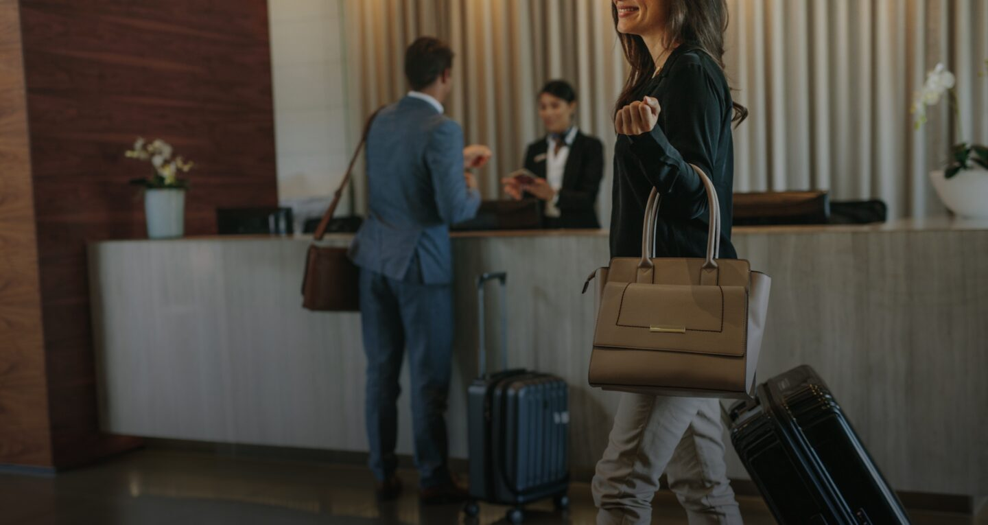 Guests checking in at a hotel front desk