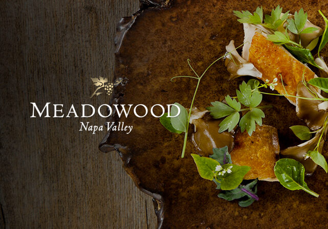 http://Meadowood%20Napa%20Valley%20over%20a%20wooden%20table%20with%20leaves