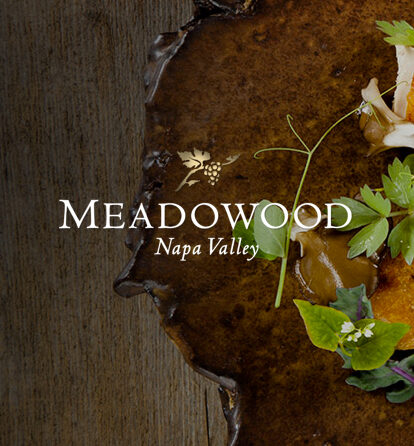 Meadowood Napa Valley over a wooden table with leaves