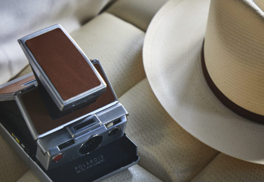 Polaroid camera and hat
