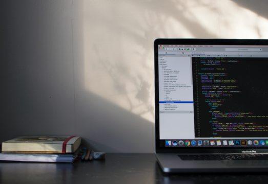 macbook with html code displayed